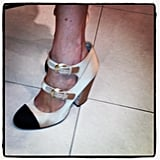 Alexa Chung finished her Moschino dress with a pair of double-strap white and black Chanel heels.