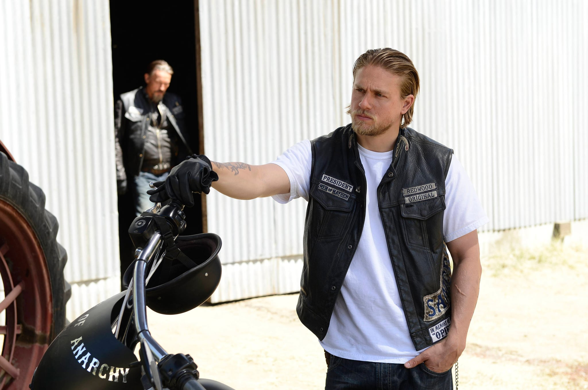 SONS OF ANARCHY, rear left: Tommy  Flanagan, foreground: Charlie Hunnam in 'Wolfsangel' (Season 6, Episode 4, aired October 1, 2013), 2008-, ph: Michael Becker/FX/courtesy Everett Collection