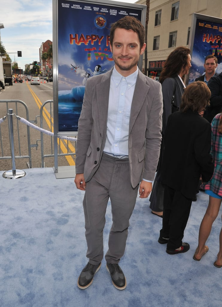 Elijah Wood was all buttoned up on the blue carpet.