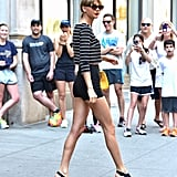 Who wears short shorts? Ultrahigh bottoms and platform sandals helped elongate and accentuate Taylor's gams.