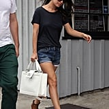 Rachel's black t-shirt, denim shorts, and leopard-print booties provide a great base for her standout bag.
