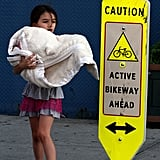 Suri Cruise carried her blanket out of Chelsea Piers in NYC.
