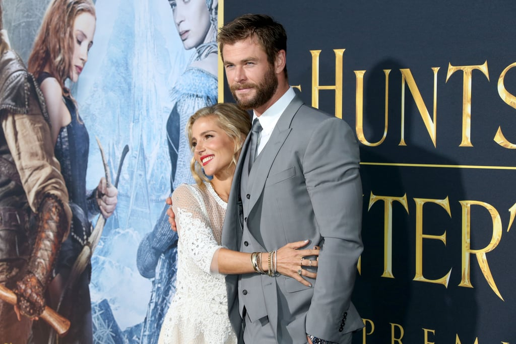 """Just days after stepping out with his brother Liam and Miley Cyrus, Chris attended the LA premiere of his latest film, The Huntsman: Winter's War, with wife Elsa Pataky by his side. On Monday, the pair hit the red carpet, where they posed for pictures and linked up with Chris's costars, including Charlize Theron and Emily Blunt, who's pregnant with her second child. Chris's appearance is just the latest stop on his busy promotional tour for the film. Last month, the Australian actor popped up in both Germany and London for a couple of photocalls, and even dropped by BBC Radio 1, where he blessed the world with a dramatic reading of Rihanna's """"Work."""" Keep reading for more photos, and then check out his night at the MTV Movie Awards on Saturday."""