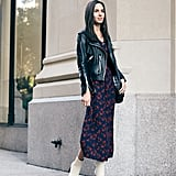 Dana styled a printed dress from the collab with a leather jacket and white boots for an easy, elevated take on day dressing that goes from the office to drinks after hours.