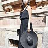 We loved the way this simple dress got an instant upgrade thanks to cool sandals and an oversize hat.