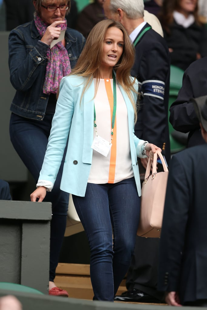 Kim kicked things off with dark denim skinny jeans and an aqua blazer.