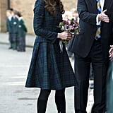 Kate Middleton made a visit to an England school in a sleek (and very duchess-like) plaid skirt suit by Alexander McQueen, which she paired with suede over-the-knee boots.