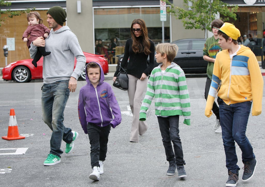 All six members of the Beckham family stepped out for lunch in Santa Monica on Saturday. Dad David held onto baby Harper while Victoria followed behind in a turtleneck. Cruz, Romeo, and Brooklyn were covered up in sweatshirts for the outing, due to the rainy Southern CA weather. David and Victoria celebrated St. Patrick's Day with their kids following a busy week spent with friends and colleagues. Victoria celebrated pal Eva Longoria's birthday at Cecconi's with Kate Beckinsale and Ken Paves on Thursday night. That day, David met up with his Galaxy teammates for a press conference at the Children's Institute. The Galaxy announced a 10-year extension to their agreement with sponsor Herbalife, with a contract that includes a charitable program to benefit the Children's Institute.