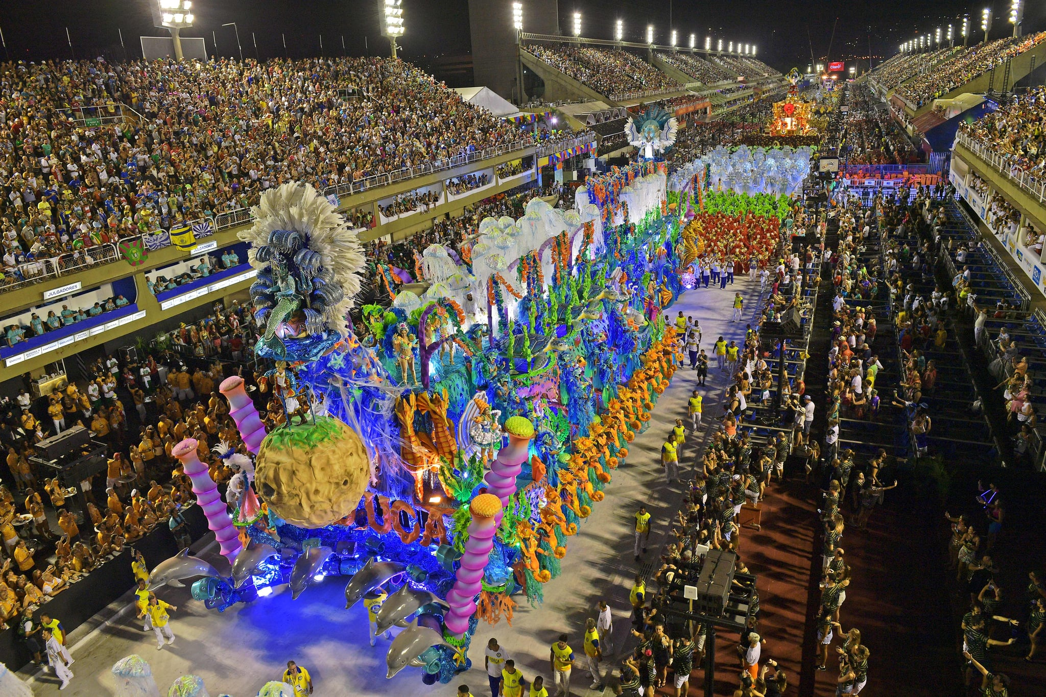 TOPSHOT - Revellers of the Unidos da Tijuca samba school perform during the second night of Rio's Carnival at the Sambadrome in Rio de Janeiro, Brazil, on February 12, 2018. / AFP PHOTO / Carl DE SOUZA        (Photo credit should read CARL DE SOUZA/AFP via Getty Images)
