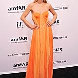 Doutzen Kroes looked beautiful in orange when she attended the amfAR Gala on Wednesday.