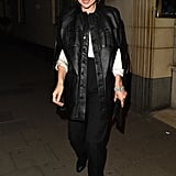 Kate Moss pairs a monochromatic look with a a very chic black leather cape coat while leaving Meg Mathews birthday party at The Dorchester.