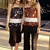 Twinning combo: For the 2002 LA premiere of Austin Powers in Goldmember, the Cali-cool combo styled their coordinating butterfly-print tops with black basics.  Ashley stuck with a dark palette, pairing her printed top with cropped black pants and buckle-accented sandals. Mary-Kate injected a pop of colour via a burnt-orange blouse and a few beaded accessories.