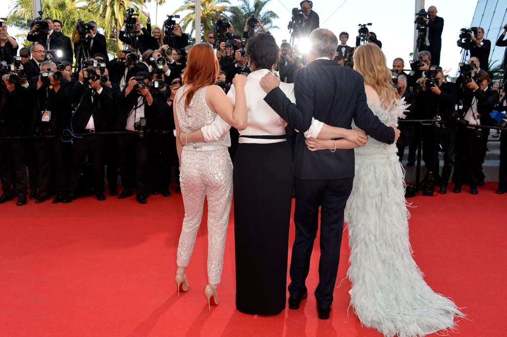 The cast of Clouds of Sils Maria — Kristen Stewart, Juliette Binoche, Olivier Assayas, and Chloë Moretz — held on to each other at the film's premiere.