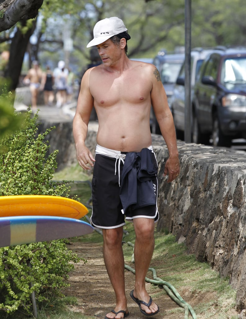 Rob Lowe walked around shirtless in Honolulu, HI, in May.