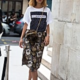 Add a basic tee to your girlie skirts.