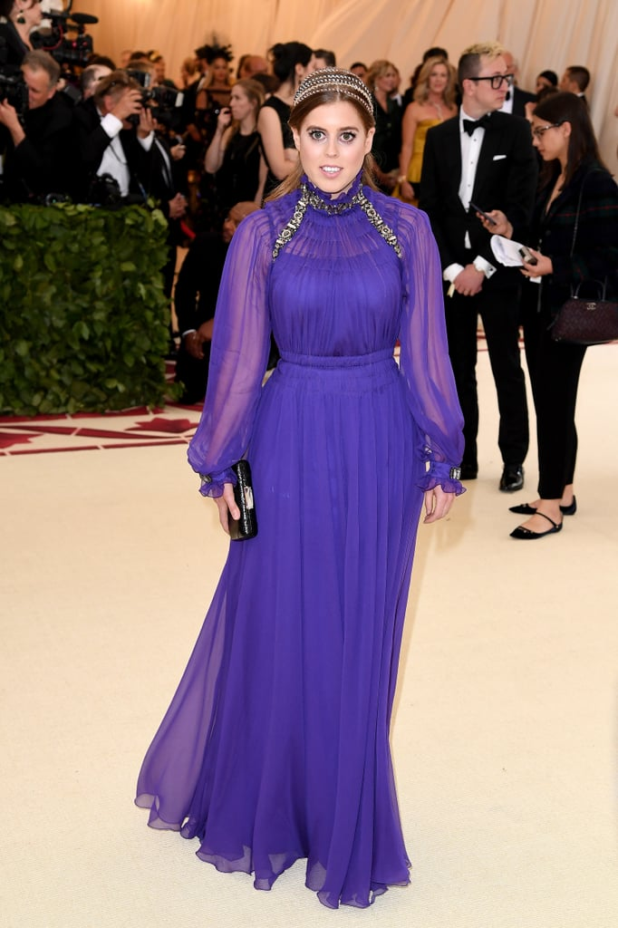 Princess Beatrice took a break from her official royal duties to attend the Met Gala in NYC on Monday. While the 29-year-old opted to wear a stylish headband instead of a tiara for the special occasion, she did seem to give a subtle nod to her family's roots with her flowing purple dress; the color purple is often associated with royalty. How fitting! Of course, this certainly isn't the first time a British royal has attended the star-studded event. The late Princess Diana famously attended the event back in December 1996.  Beatrice certainly has a busy few months ahead of her. While her sister Princess Eugenie is set to tie the knot in October, Beatrice will first attend her cousin Prince Harry's wedding to Meghan Markle later this month. Until then, enjoy her fabulous outing across the pond below.