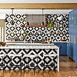 There's no denying it: this kitchen mixes bold colours and patterns seamlessly. This graphic geometric design is offset with the perfect touch of blue.
