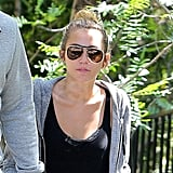 Miley Cyrus pulled her hair back for her midday workout.
