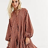 ASOS DESIGN Trapeze Mini Dress with Godets in Seersucker Check ($64)