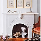 Make a mini art display in your fireplace with sculptural and natural objects. I love the complementary shapes of the coral and the bust in this photo!  Source