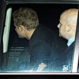 Prince Harry ducked into his car after a late night out.