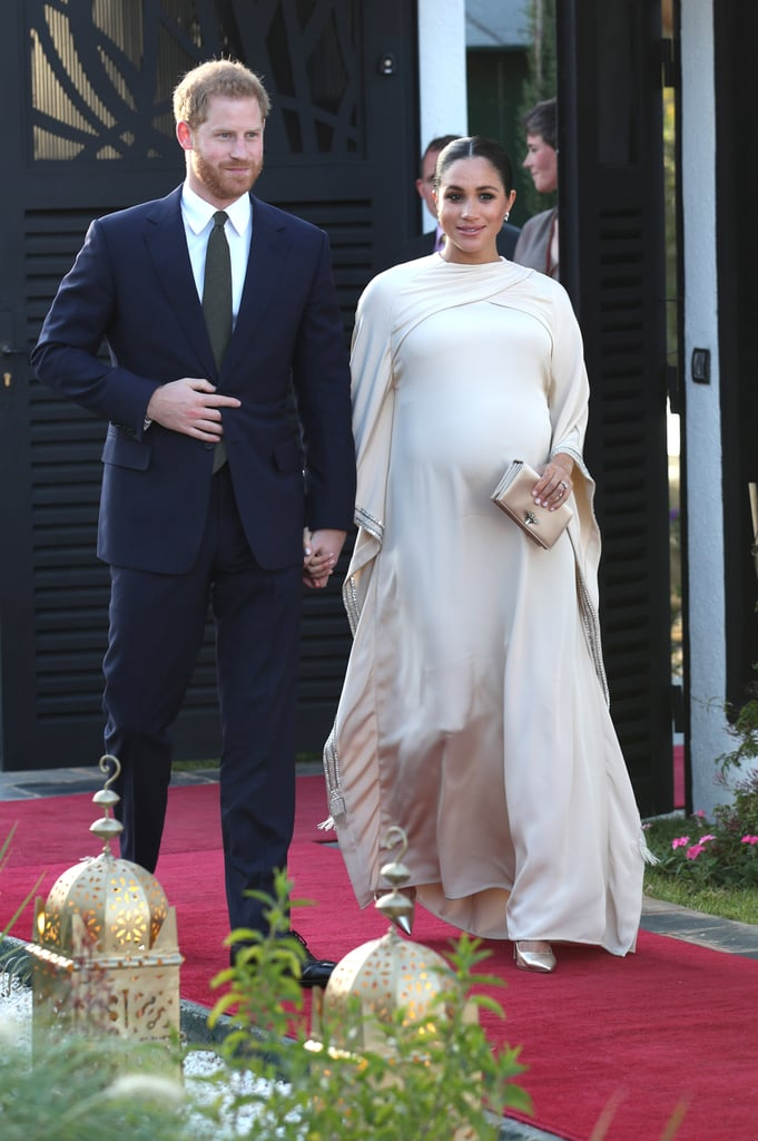 Did you think the Oscars would be serving up the only red carpet gowns worth seeing this weekend? Clearly, you didn't get the memo that the Duke and Duchess of Sussex were off to a banquet. During their royal tour of Morocco, Harry and Meghan were invited to the formal dinner in Rabat by the British ambassador, Thomas Reilly, and his wife Leah. For the occasion, Meghan pulled out all the stops by choosing a custom gown by Dior, which seemed to pay homage to the kaftans worn by many Moroccans. The sweeping dress with its crossover neckline featured a jeweled trim, which perfectly complemented Meghan's diamond earrings, which are her much-loved Birks snowflake diamond studs. She finished the look with a pale gold clutch bag and matching heels. It's the third outfit we've seen on Meghan since she and Harry touched down in Morocco, and it's safe to say it's the most glamorous yet. Take a closer look at this stunning bespoke creation ahead.