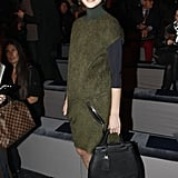 Natalie Vodianova kept it chic in a suede jumper at Louis Vuitton.