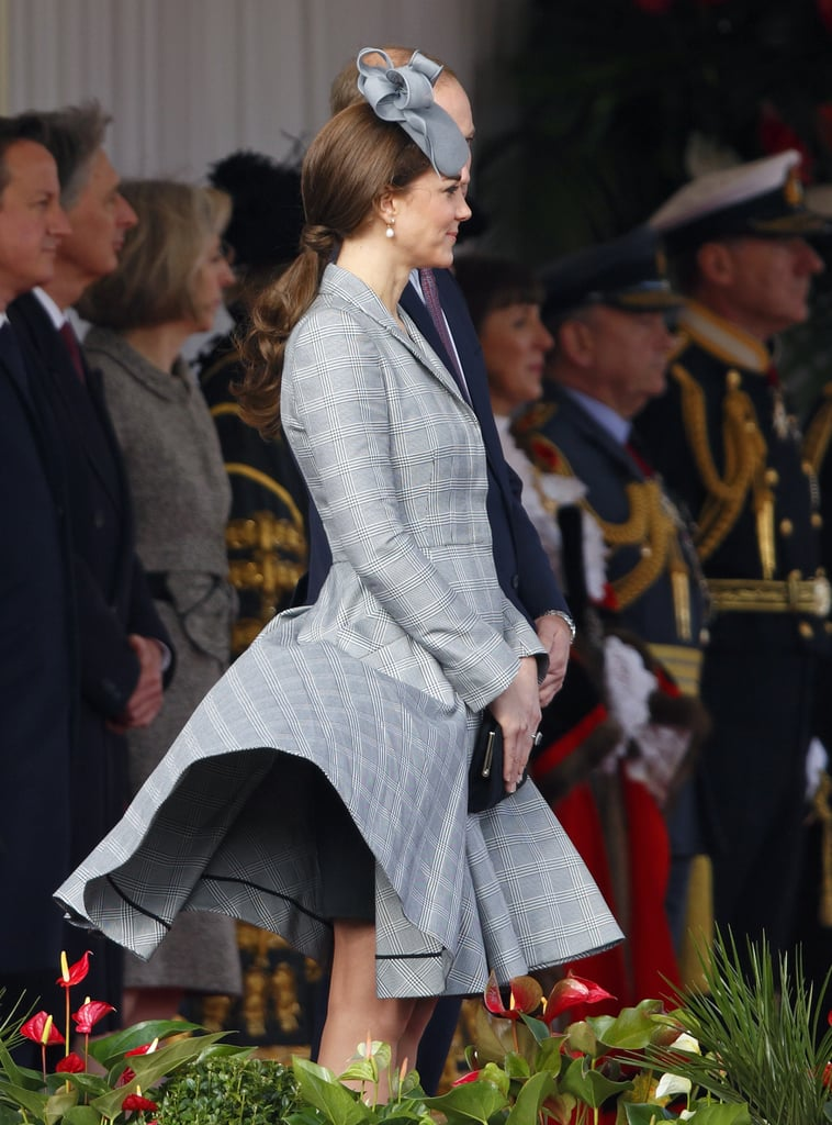Kate made her first official appearance after announcing her first pregnancy while welcoming Singapore's president to the UK in October 2014. She covered up in a bespoke Alexander McQueen coat, which caught a stiff breeze. Hey, at least her hat stayed on.