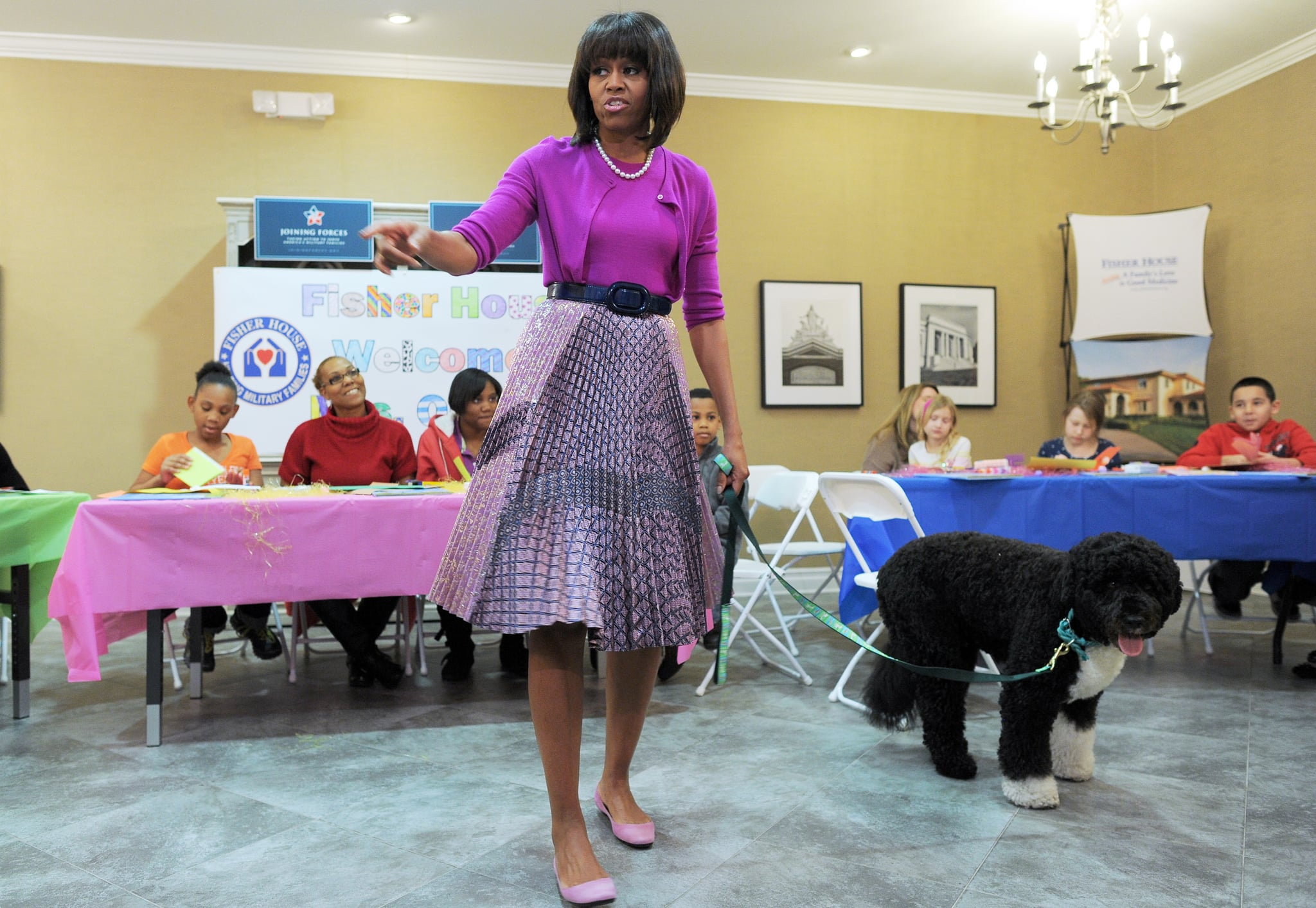 During Easter weekend, she belted a fuchsia-hued J.Crew Collection sweater set with a printed and pleated knee-length skirt, then finished off the entire look with sweet pastel pink flats.