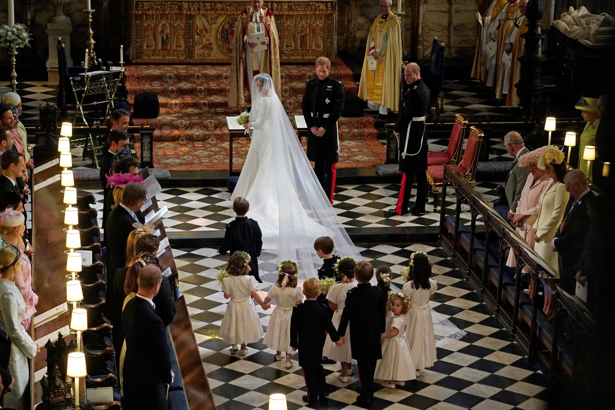 Britain's Prince Harry, Duke of Sussex (centre R) and US actress Meghan Markle (centre) stand at the altar with their bridsesmaids and page boys in St George's Chapel, Windsor Castle, in Windsor, on May 19, 2018 during their wedding ceremony with best man Britain's Prince William, Duke of Cambridge, (R) standing to the side. (Photo by Owen Humphreys / POOL / AFP)        (Photo credit should read OWEN HUMPHREYS/AFP/Getty Images)