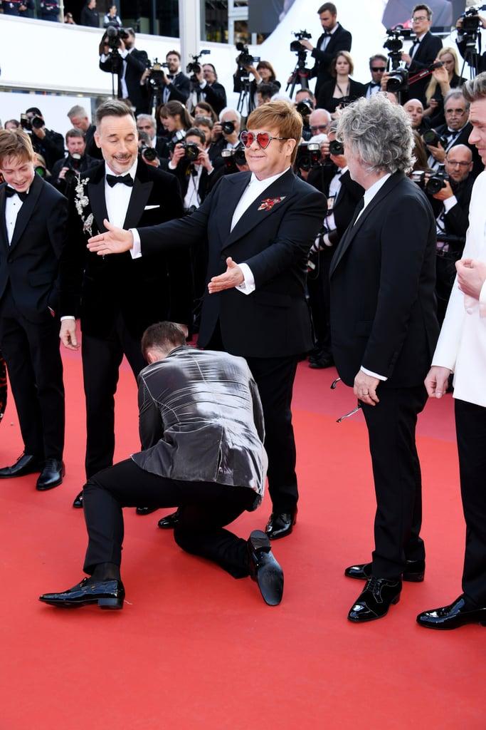 Next, Elton Takes a Moment to Show Off Taron's Shoe-Tying Skills