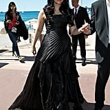 Wearing a sheer black strapless gown by Aashi Studio.