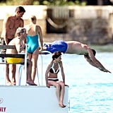Naomi Watts hung out with friends while Liev Schreiber dove into the water in Barbados.