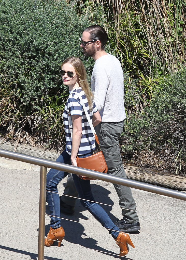 Kate and Michael do the Bondi to Bronte walk. Her, in heels.