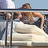 Leo greeted a female friend who hopped on the yacht on Tuesday.