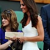 Kate's favorite Stuart Weitzman 'Muse' style in beige snakeskin at Wimbledon in 2011.