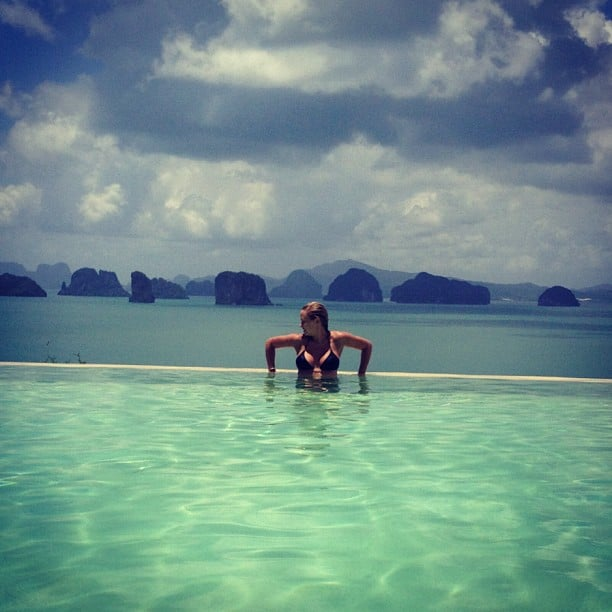 Lara Bingle wore a black bikini in an infinity pool. Source: Instagram user mslbingle