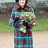 Kate's arms were full of flowers as she attended church in Sandringham in 2017.