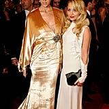 Britt Maren in custom Winter Kate, with the designer Nicole Richie