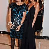 Victoria in a black vacation dress with DVF at the Harper's Bazaar Women of the Year Awards in 2014.