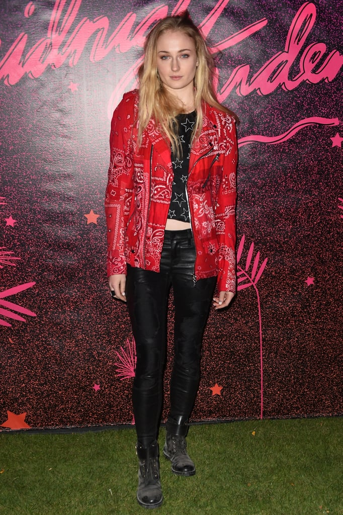 Sophie Turner wearing a bandana-printed moto jacket at the Nylon Midnight Garden After Dark party.