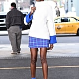 Small color accents head-to-toe make for an eye-catching miniskirt look.