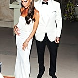 David kept a hand on Victoria's hip as they headed into the event.