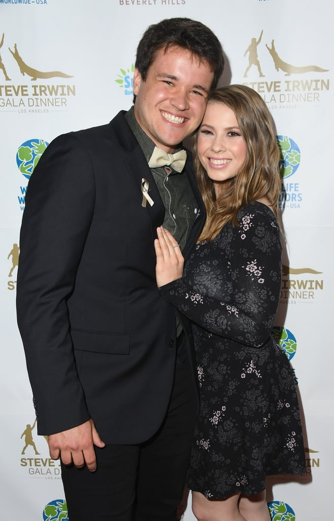 Bindi Irwin and her longtime boyfriend Chandler Powell are engaged! The 21-year-old conservationist announced the exciting news on Instagram with a handful of sweet photos of Chandler proposing. The couple first met in 2013 when she was asked to lead his tour group around the Australia Zoo. Since then, they've been all around the world together, hiking through nature and visiting wildlife preserves. Chandler even visited Bindi during her winning stint on Dancing With the Stars. No matter how solid your relationship is, looking through these pictures will make you envious of their sweet romance.       Related:                                                                                                           23 Beautiful Photos Bindi Irwin Has Shared of Her Late Father, Steve
