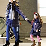 Suri Cruise held on tight to mom Katie Holmes's hand.