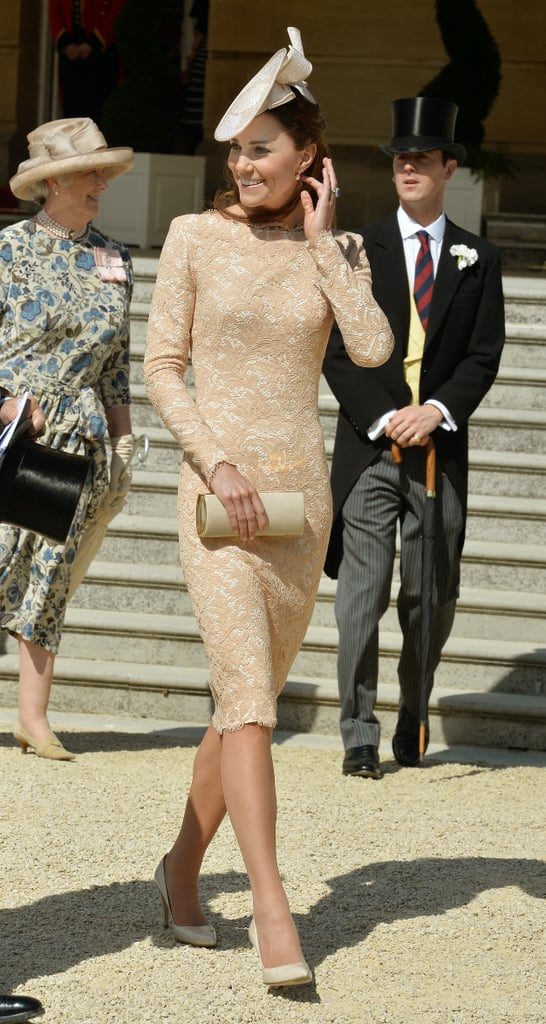 """The Duchess of Cambridge may have been busy attending to her royal duties earlier on Tuesday morning, but she couldn't pass up the opportunity to attend Prince Philip's 93rd birthday party at Buckingham Palace later in the day. Kate Middleton traded the black and white Jaeger dress that she wore to a breakfast reception for the America's Cup earlier in the day for a peach-colored Alexander McQueen frock and matching hat by Jane Taylor. She stayed by Queen Elizabeth II and Philip's side as they greeted a few of their party guests at the palace's impressive gardens. The guest list is said to have numbered into the thousands and was made up of people who, as the palace puts it, have made a """"contribution to the UK and the Commonwealth."""" Other royal guests included Princess Anne and Princess Eugenie.  Kate's royal duties aren't over just yet as she will join the royal family on Sunday for the annual Trooping the Colour event in London. The event is meant to serve as the sovereign's official public birthday celebration, despite the fact that the queen's actual birthday is on April 21. While the tradition sounds a bit confusing, it is actually meant to allow the public to celebrate the sovereign's special day during a time when there is good weather. (Fingers crossed!) Avid royal watchers will remember that last year's Trooping the Colour was the duchess's last official appearance before going on maternity leave to await the arrival of Prince George. Scroll down to see more pictures from Philip's birthday bash, and be sure to check back for more photos as they come in!"""