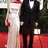 Brad Pitt brought his cane to the red carpet at the Golden Globes with Angelina Jolie.