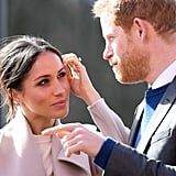 Meghan Markle Looking at Prince Harry Pictures