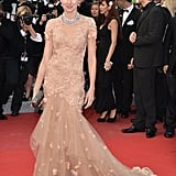 Naomi Watts showed off her figure in a gown in Cannes.