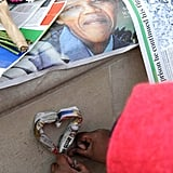 A woman paid her respects at a Nelson Mandela statue in the UK.